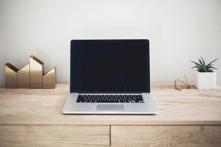 Open laptop on desk, New Entrepreneur Tech