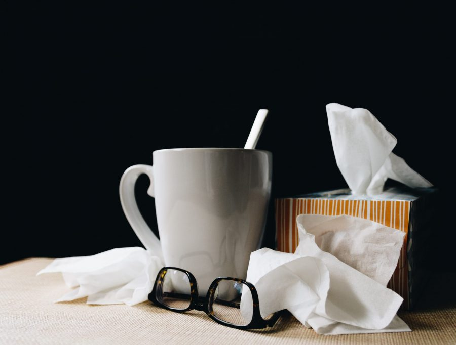 Cup of tea with box of tissues